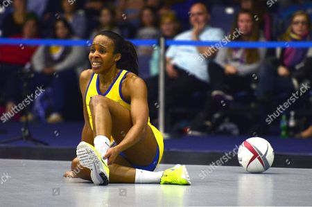 Pamela Cookey of Team Bath sits on the court with an injured ankle