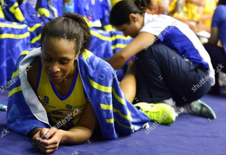 Pamela Cookey of Team Bath receives treatment to an ankle injury