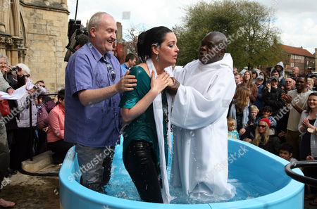 Hannah Jefferson, from The Ark Church in York is baptisedby the Archbishop of York, Dr John Sentamu with Minister Stephen Redman (L) assisting