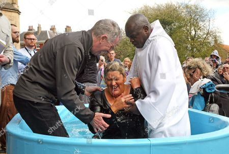 Clare Anne Holtby-Grey, from the Elim Pentecostal Church in York is baptisedby the Archbishop of York, Dr John Sentamu with Minister Graham Hutchinson (L) assisting