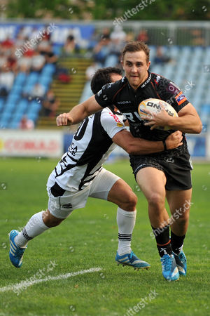 Tom Habberfield tackled by Luciano Orquera