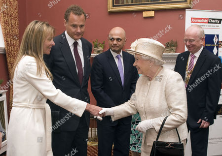 Queen Elizabeth II with Lord Rothermere, President, Journalists' Charity, Lady Rothermere, Tom Hempenstall, Master of Stationers' Company and Sajid Javid, Culture Secretary