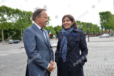 Mayor of Paris Anne Hidalgo and Jean Pierre Bel are pictured at the statue of General Charles De Gaulle in Paris as part of a ceremony marking the 69th anniversary of the Allied victory over Nazi Germany in World War II