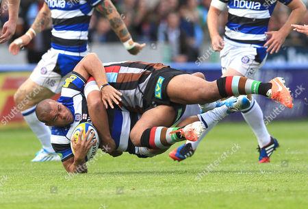 Harlequins' Jordan Turner-Hall takes out Jonathan Joseph of Bath Rugby with a thumping tackle Harlequins v Bath - Aviva Premiership - Twickenham Stoop - 10/05/2014 - London - UK Mandatory Credit: Andrew Fosker / Seconds Left Images
