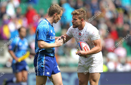 England's Tom Mitchell argues with the referee - Richard Kelly (NZ) - after they were denied a re-start instead of a conversion with time on the clock and consequently lost the semi-final to Australia 12- 15 - Cup Semi-Final - England v Australia IRB World Series 7s -  London - Twickenham Stadium - 11/05/2014 - London - UK Mandatory Credit: Andrew Fosker / Seconds Left Images /Rex