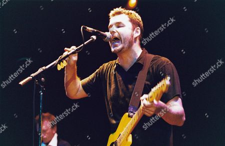 Editorial photo of STUART ADAMSON WITH BIG COUNTRY PERFORMING AT SHEPHERDS BUSH EMPIRE, LONDON IN MAY 2000