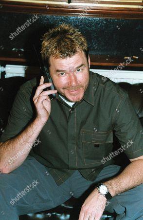 Stock Photo of STUART ADAMSON ON MOBILE PHONE
