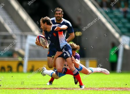 France sevens Terry Bouhraoua is tackled by Scotland sevens Colin Gregor