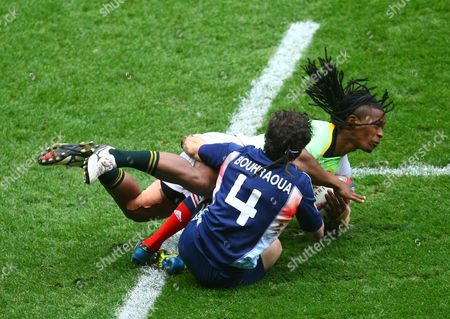 South Africa sevens Cheslin Kolbe  is tackled by France sevens Terry Bouhraoua