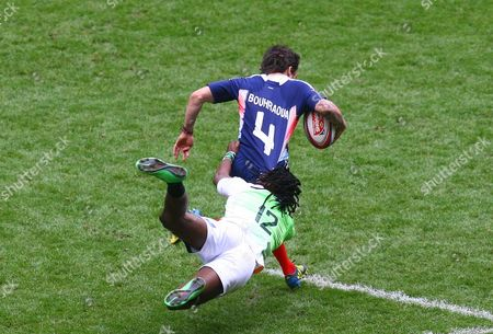 France sevens Terry Bouhraoua is tachled by South Africa sevens Cheslin Kolbe