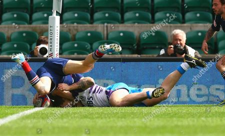 Scotland sevens Michael Maltman scores a try while being tackled by France sevens Terry Bouhraoua