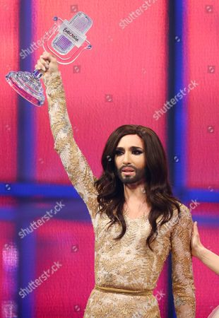 Conchita Wurst of Austria wins the Eurovision Song Contest 2014 and recieves the trophy