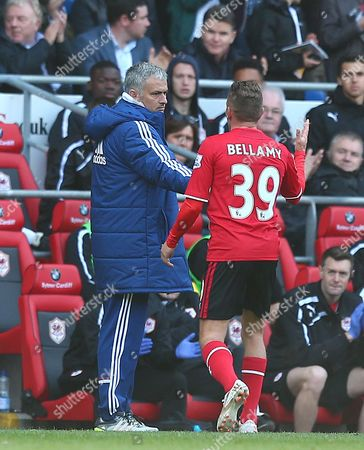 Chelsea manager Jose Mourinho shakes hands with Craig Bellamy of Cardiff City as he is substiuted in what could be his final match before retirement