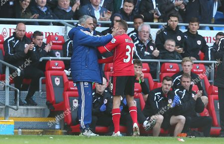 Chelsea manager Jose Mourinho hugs Craig Bellamy of Cardiff City as he is substiuted in what could be his final match before retirement