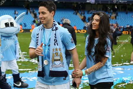 Samir Nasri of Manchester City with girlfriend Anara Atanes at the end of the game