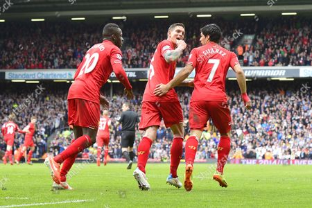 Liverpool's Daniel Agger celebrates scoring the equalising goal. 1-1