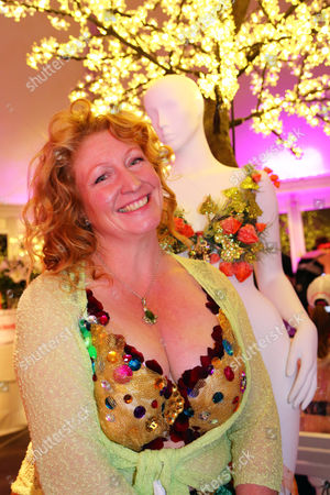 Stock Picture of Charlie Dimmock, gardening expert and TV presenter wearing a fancy dress bra in the Walk the Walk Moonwalk 2014