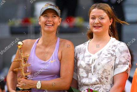 Stock Image of Maria Sharapova of Russia holds up the winners trophy with Dinara Safina at the Mutua Madrid Open 2014