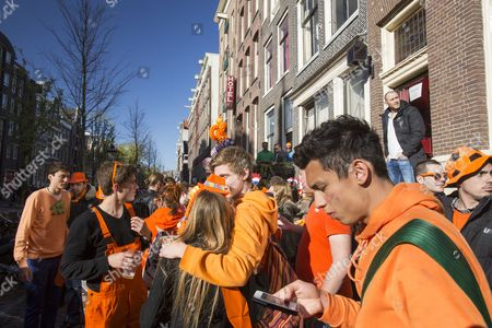 Crowds celebarate Queen Beatrix abdicating and handing over the throne to Crown Prince Willem Alexander in the centre of Amsterdam, Netherlands.