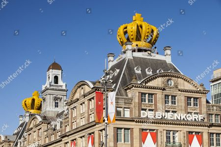 A building with an inflateable crown to celebarate Queen Beatrix abdicating and handing over the throne to Crown Prince Willem Alexander in the centre of Amsterdam, Netherlands.