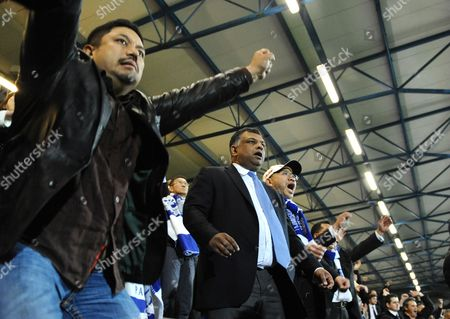 QPR Co-owners, l-r, Ruben Emir Gnanalingam, Tony Fernandes and Kamarudin Bin Meranun look nervous as full time approaches