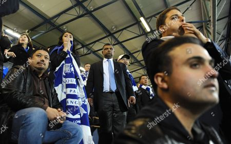 As full time approaches, QPR co-owners, l-r, Ruben Emir Gnanalingam, Tony Fernandes and Kamarudin Bin Meranun look nervously on