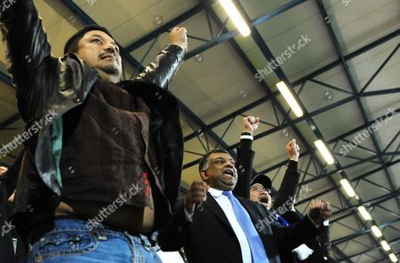 QPR co-owners, l-r, Ruben Emir Gnanalingam, Tony Fernandes and Kamarudin Bin Meranun celebrate on the final whistle