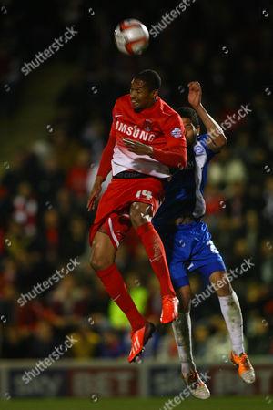 Leyton Orient's Shaun Batt battles with Peterborough's Nat Knight-Percival