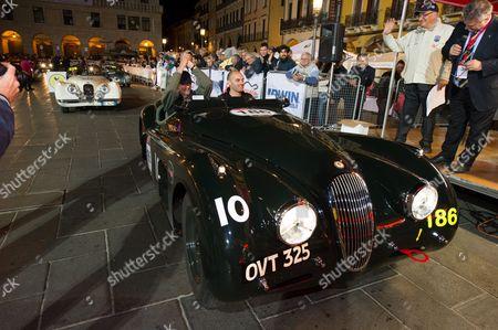 Jeremy Irons and Charlie Turner driving Jaguar XK 120 finish 1st leg in Padua