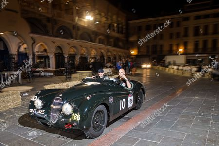 Jeremy Irons and Charlie Turner arrive in Padua at the finish of Day one of the Mille Miglia 2014 in thier Jaguar XK 120