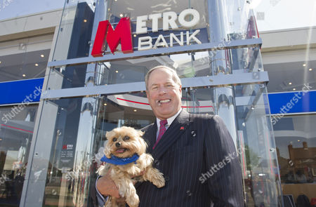 Metro Banking Boss Vernon Hill At The New Drive Through Bank In Slough. Sir Duffield The Dog Poses With Mr Hill.