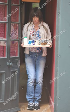 Chris Huhne's Partner Carina Trimingham Brings Tea To Tv And Press Men Waiting Outside Their Home A Few Hours His Release From Prison Two Months Into His Eight Month Sentence For Perverting The Course Of Justice. See Story.