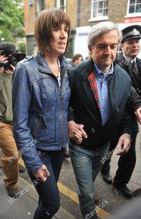 Stock Image of Disgraced Former Mp Chris Huhne Returns To His Central London Home With His Partner Carina Trimingham Hours After His Early Release From Prison.