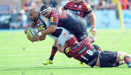 Harlequins' Jordan Turner-Hall ball in hand is felled by Alistair Hargreaves (19) and James Johnston (on top) - Rugby Union - Saracens v Harlequins - Aviva Premiership Semi-final - 17/05/14 - At Allianz Park, Hendon London, UK Photo Credit - Tom Dwyer/Seconds Left Images - All rights reserved