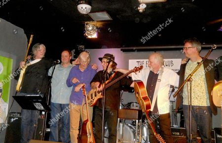 Original Yardbirds member Jim McCarty (third from left) moves from drums to guitar for his alternative band 'Jim McCarty's Flipside', fellow Yardbird Top Topham on the left in concert the Eel Pie Club, Twickenham