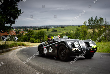 Jeremy Irons and Charlie Turner driving their Jaguar XK 120