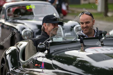 Jeremy Irons and Charlie Turner in thier Jaguar XK 120 at the start of Day 2 of the 2014 Mille Miglia in Thermae Abano Montegrotto. Italy