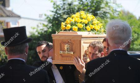 Husband Nino Severino follows the coffin with the help of Judy Murray