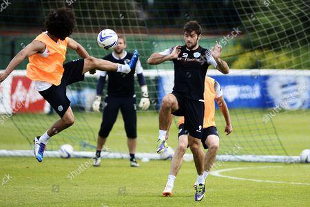 Benoit Assou-Ekotto and Charlie Austin of QPR