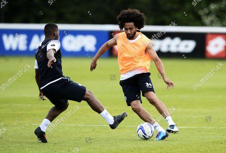 Benoit Assou-Ekotto takes on Danny Simpson of QPR