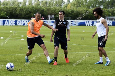 L-R Bobby Zamora, Joey Barton and Benoit Assou-Ekotto of QPR during training