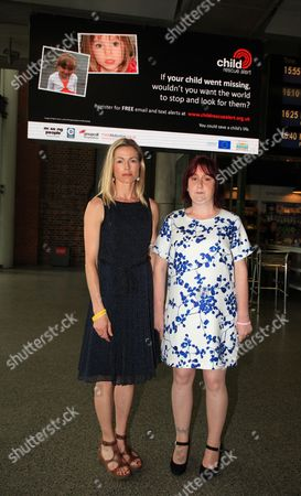 Kate McCann, mother of Madeleine, and Coral Jones, mother of April, in front of the billboard