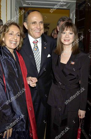 RUDOLPH GIULIANI WEARING HIS HONORARY KBE MEDAL WITH JUDITH NATHAN (R) AND GEMMA LEVINE