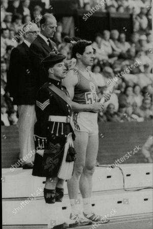Commonwealth Games Edinburgh 1986. The Duke Of Edinburgh Opens The Commonwealth Games Receives A Baton From Sprinter Allan Wells.
