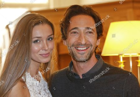 Lara Leito and Adrien Brody