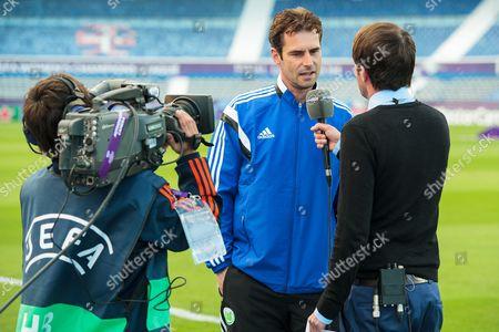 Wolfsburg manager Ralf Kellermann is interviewed by Eurosport Television