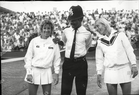 Pc Les Bowie Keeps Wimbledon Women's Finalists Chris Lloyd (l) And Martina Navratilova (r) At A Friendly Arm's Length After A Doubles Match. (chris Evert / Chris Evert Lloyd ).