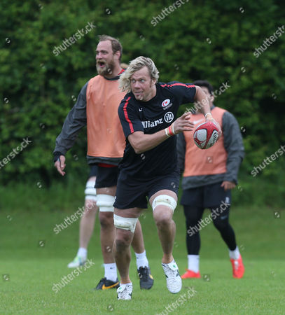 Mouritz Botha of Saracens runs away from teammate Alistair Hargreaves