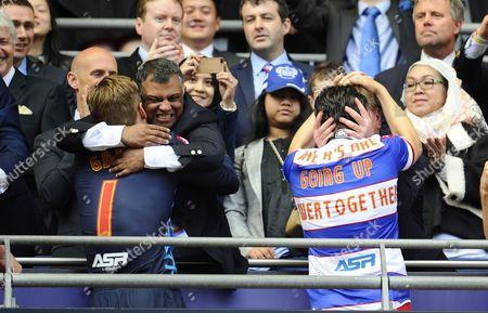 QPR co-owner Tony Fernandes celebrates with goalkeeper Robert Green as Chief Executive Philip Beard hugs Joey Barton