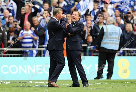 QPR CEO Philip Beard shares a joke with manager Harry Redknapp at the end of the game